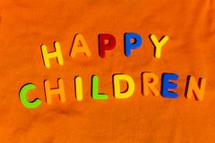 The word Happy Children composed from letters. The word Happy Children composed from colorful children toy big letters on the grass royalty free stock photos