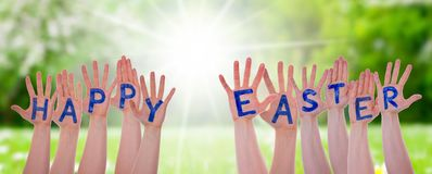 Word Happy Easter On Hands, Sunny Meadow Royalty Free Stock Photography