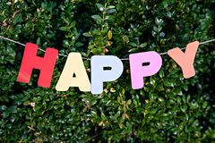 Word Happy by letters on trees background Royalty Free Stock Image