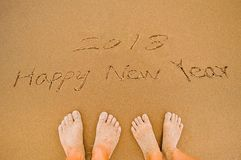 2018 Happy new year. Word 2018 happy new year write on beach to lovers Stock Images