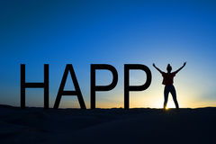 Word happy and silhouette of a woman standing Stock Photos