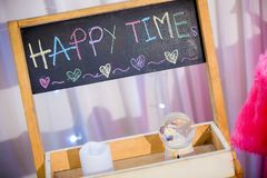 Word HAPPY TIME, hand writing on blackboard. chalkboard with colorful chalk. Stock Image