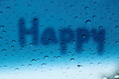 The word Happy write on glass with raindrop Stock Images