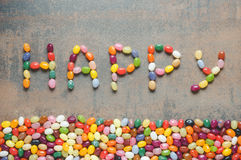 Word happy written with jelly beans Stock Images