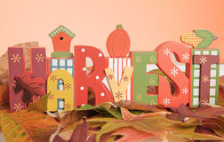 The word harvest Symbolizing Fall. The word harvest on a Colorful Fall Leaves Background royalty free stock photography