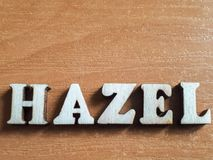 The word `hazel` made of wooden letters. Wood inscription on table royalty free stock images