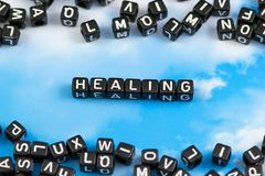 The word healing. On the sky background royalty free stock photography