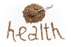 The word health made of buckwheat grains isolated on a white background Royalty Free Stock Photography
