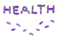 Inscription health from a set of colorful pills isolated on white background royalty free stock photo