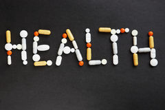 Word HEALTH made of various pills Royalty Free Stock Photography