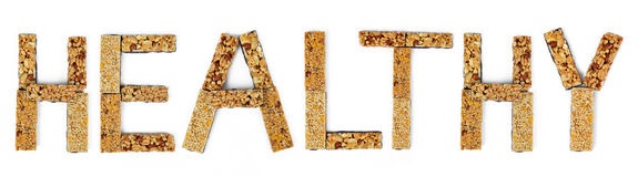 The word Healthy from muesli bars Stock Photos