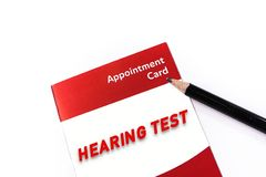 Word HEARING TEST on medical check up appointment card Royalty Free Stock Photo
