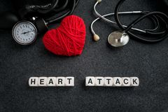 Word HEART ATTACK from white cubes with letters on dark backgrou royalty free stock photos