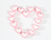 Word heart from pink sweets isolated Stock Photos