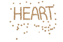The word heart spelled out in cheerios. On a white background Stock Photos