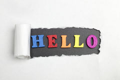 The word Hello. Broken sheet of paper followed by the word hi Stock Photography