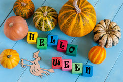 Word Helloween On child's toy cubes and pumpkins Royalty Free Stock Photography
