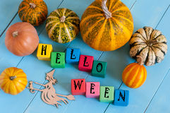 Word Helloween On child's toy cubes and pumpkins Royalty Free Stock Photo