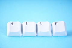 The word help. On blue background Royalty Free Stock Photography
