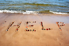 Word HELP on beach sand Stock Photos