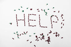 Word help created by pills. On white background in studio Royalty Free Stock Photography