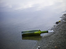 The word 'help' enclosed in a bottle Royalty Free Stock Photo
