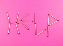 Word Help made of matchsticks Royalty Free Stock Photography