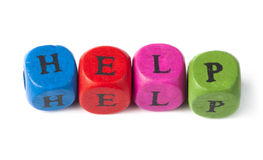 Word help on multicolored wooden cubes Stock Images