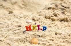 Word help from multicolored wooden letters Stock Image