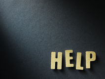 The word Help on paper background Stock Images