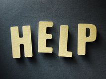 The word Help on paper background Stock Image