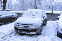 Word help on snow covered car. Winter transportation problems Royalty Free Stock Images