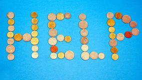 Word help written in coins Stock Images