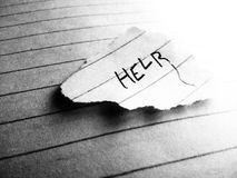 The word help written on the piece of paper royalty free stock photos
