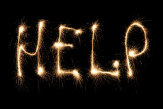 Word help written sparkler Royalty Free Stock Image