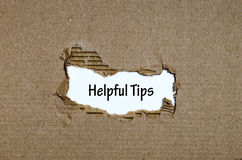 The word helpful tips appearing behind torn paper. The word helpful tips behind torn paper Royalty Free Stock Photography