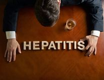Word Hepatitis and devastated man composition Stock Photos