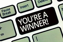 Word het schrijven de tekst u aangaande is een Winnaar Bedrijfsconcept voor het Winnen als 1st plaats of kampioen in de concurren stock foto