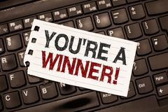 Word het schrijven de tekst u aangaande is een Winnaar Bedrijfsconcept voor het Winnen als 1st plaats of kampioen in de concurren stock afbeeldingen