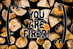 Word het schrijven de tekst wordt u in brand gestoken Bedrijfsconcept voor het Weggaan van de baan en geworden werkloos de carriè royalty-vrije stock foto's