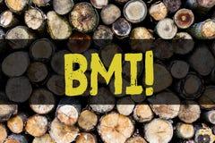 Word het schrijven tekst Bmi Het bedrijfsconcept voor Body mass index bepaalt gezonde gewichtswaaier met betrekking tot hoogte royalty-vrije stock afbeelding