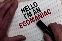 Word het schrijven tekst Hello ben ik een Egomaniac Bedrijfsconcept voor de Egoïstische Egocentrische Narcissist zelf-Gecentreerd stock foto