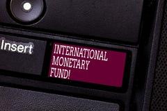 Word het schrijven tekst Internationaal Monetair Fonds Het bedrijfsconcept voor bevordert internationaal financieel stabiliteitst stock afbeeldingen