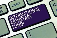 Word het schrijven tekst Internationaal Monetair Fonds Het bedrijfsconcept voor bevordert internationaal financieel stabiliteitst royalty-vrije stock afbeelding