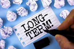 Word het schrijven tekst Motievenvraag Op lange termijn Bedrijfsconcept voor het Voorkomen over grote periode Toekomstige die pla royalty-vrije stock afbeeldingen