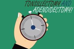 Word het schrijven teksttonsillectomie en Adenoidectomy Bedrijfsconcept voor Procedure in het verwijderen van amandel en kliervor royalty-vrije stock foto's