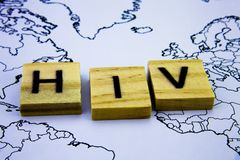 The word HIV written with wooden letters blocks above map. Health concept with word HIV. stock images