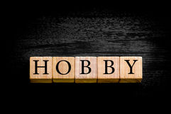 Word HOBBY isolated on black background with copy space Royalty Free Stock Image