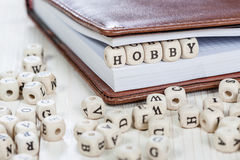 Word HOBBY on old wooden table. Stock Images