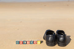Word HOLIDAY in colorful alphabet blocks andblack shoe on tropic Royalty Free Stock Images